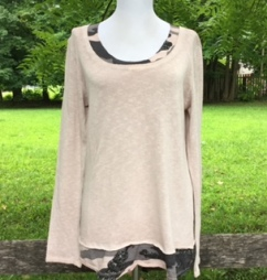This lightweight, 100% cotton top provides a layered look and is perfect for fall!