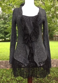 This fun top provides a layered look without the bulk. It's perfect for fall paired with leggings and boots!