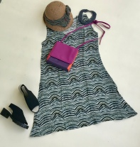 Pair this lightweight dress with chunky necklace and bright bag for a day of fun with friends