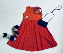 Throw caution to the wind in this flowy, red dress. Perfect for date night